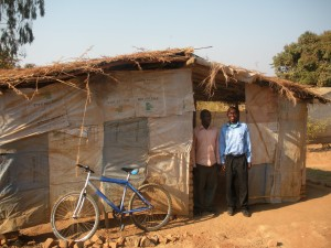 Pastor Arnold in front of his church in Malawi