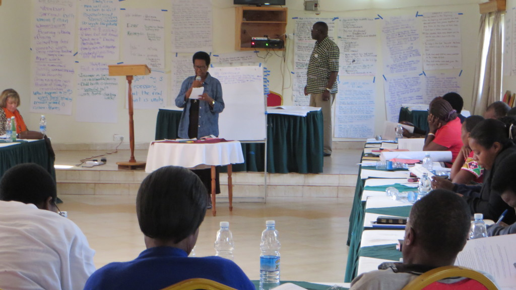Canon Grace facilitates, with Frank Tweheyo and Donell.