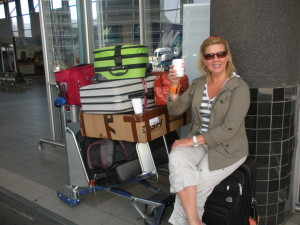 Aimee with luggage including a water cart