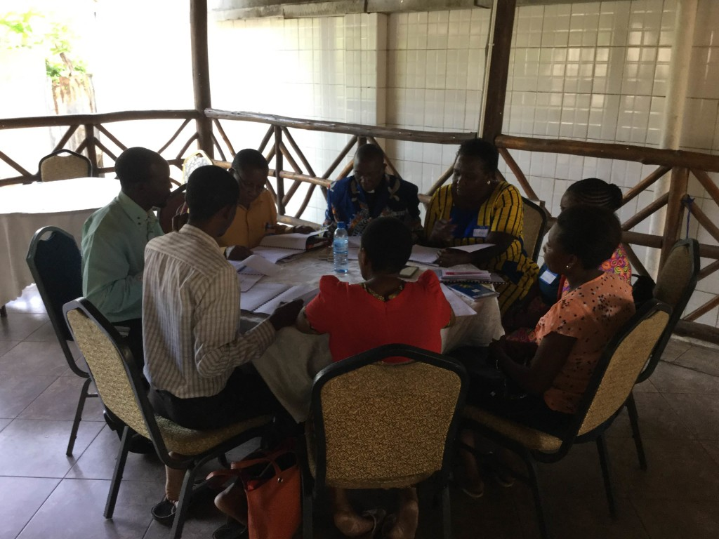 A group studies together at the Tanzania seminar.