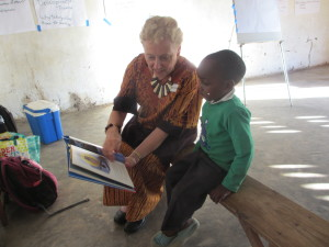 Linda reads with a child in Malawi.
