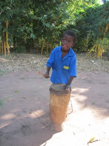 A little drummer in Malawi greets us.