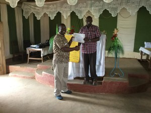 Pastor David receives his certificate.